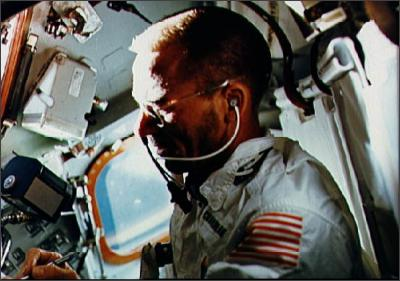 An astronaut using the Fisher Space Pen in Outer Space