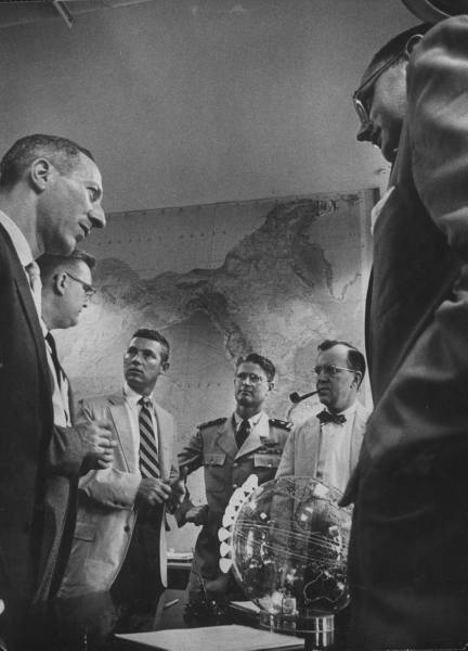 Dr. Milton W. Rosen w. John T. Mengel, Project Director J. P. Walsh, Lieut Commander J. W. Salter and Project Director John P. Hagen Scientists working on US man-made satellite.  John P. Hagen is the best with his bowtie and pipe.