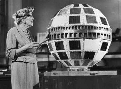 AT&T stockholder Mrs. Louise Bucker looking at full-size model of the Telstar experimental communications satellite - AT&T's Bell Laboratories 1960