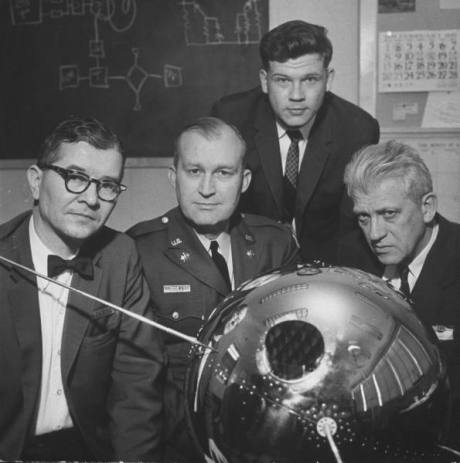 Colonel Harold Brown (C) w. Dr. Hans Ziegler (L), John Licht (2R) and Dr. Harold Zahl (R) with US weather satellite ready for launching - 1959