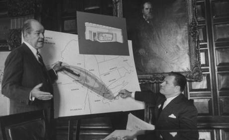 Business Executive, Keith S. McHugh, arguing the advantages of fallot shelters for every home with Governor Nelson A. Rockefeller - LIFE archive 1960