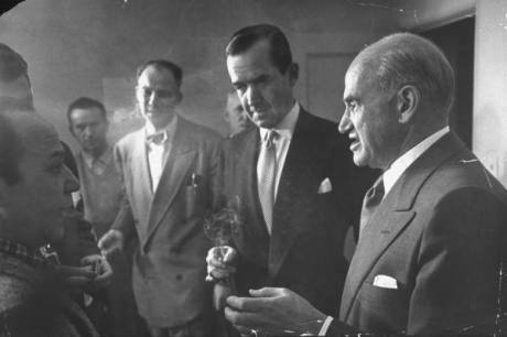 """Composer Frank Loesser, CBS TV producer Edward R. Murrow, Samuel Goldwyn (L-R) & unident. others in Goldwyn's office during CBS crew's visit to set of filming of motion picture """"Hans Christian Andersen"""" - 1952"""