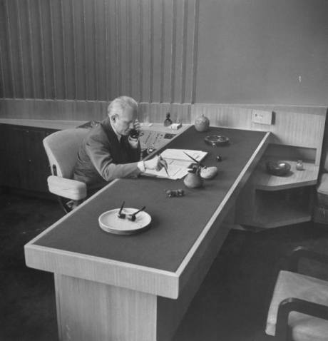 CBS President Frank Stanton sitting at his desk - 1948