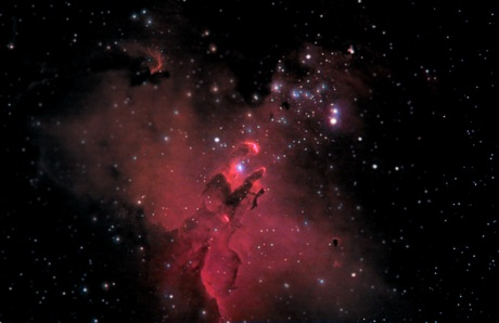 """Eagle Nebula - The dark figure is in the form of an eagle with its wing spread to the back, and its """"talons"""" seemingly grasping a struggling fish. A fanciful description of a striking star forming nebula in our galaxy."""
