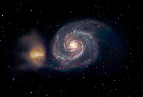 """The """"Whirlpool"""" galaxy is seen rotating in a counter clockwise direction. Note the smaller, yellow galaxy on the left. It has passed quite close to the larger galaxy. This near encounter has resulted in the """"plumes"""" of material coming out of it, and a long arm has been drawn out of the """"Whirlpool"""" towards it."""
