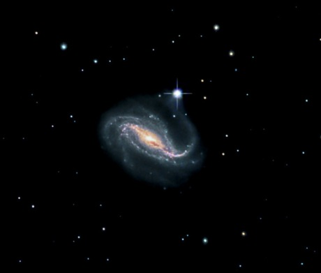 A beautiful barred spiral at 64 million light years away