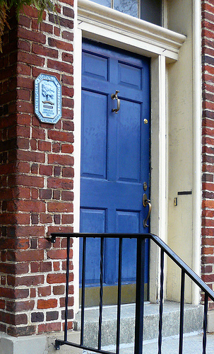 Great blue door with the historic landmark plaque