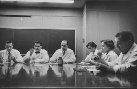 Scientists at panel discussing medicine.