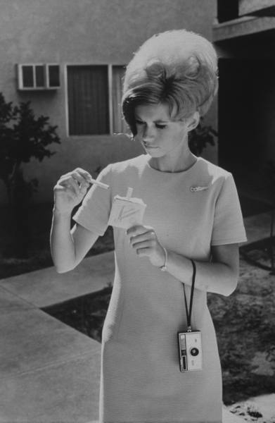This stewardess is getting her cigarettes ready for the flight!