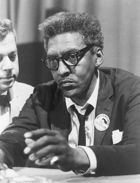 Bayard Rustin in a great skinny with AWESOME black rim specs