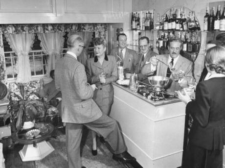 Loewy entertaining guests at the bar