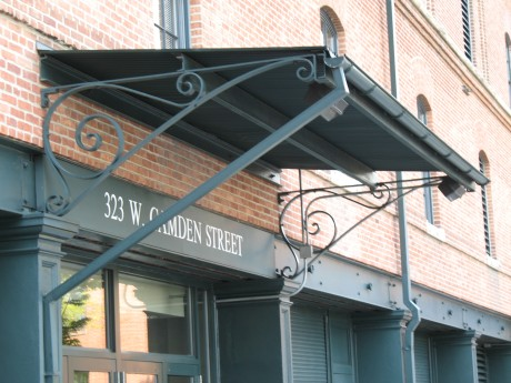 Wrought Iron awnings.  I love that the stadium uses Loden green and brick.