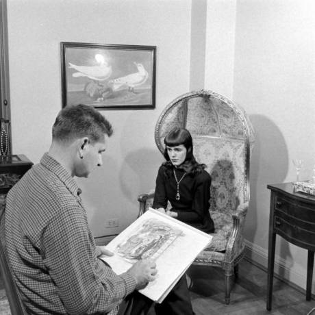 "Charles Addams sketching a model posing as Morticia Addams for ""The Addams Family cartoon"" (1946)"